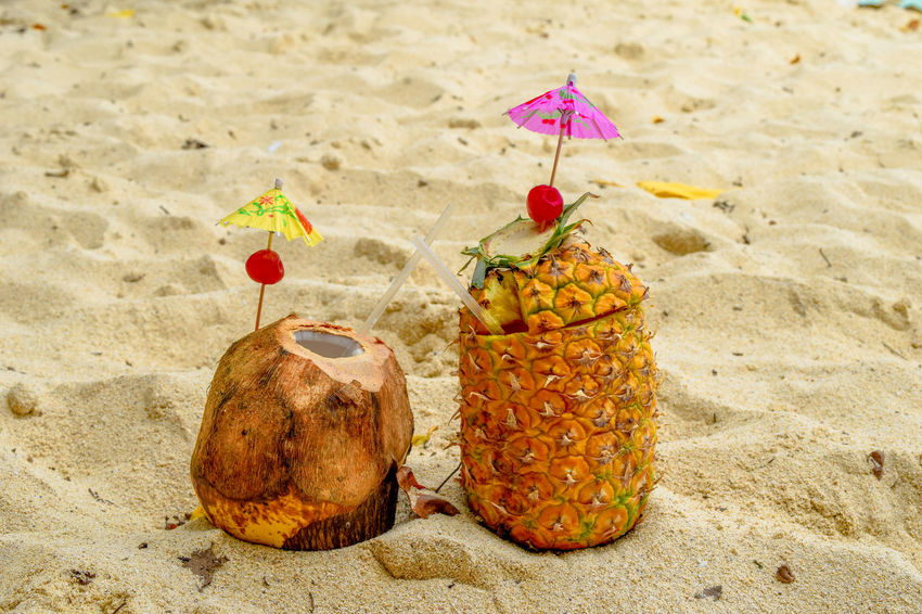 Coconut and pineapple cocktail on the beach in the sand Cherry Exotic Juice Palm Alcohol Alcoholic Drink Bacardi Island Beach Beachphotography Caribbean Cayo Levantado Close-up Day Drink Food Nature No People Outdoor Photography Outdoors Piña Colada Relax Sand Sand Pail And Shovel Sandy Vacation