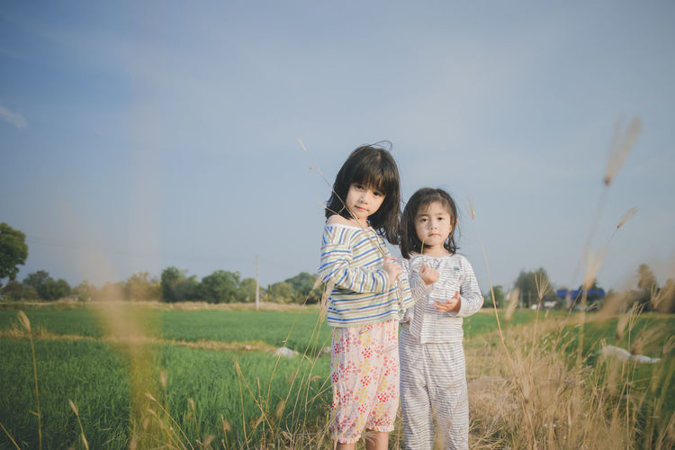 Cute two dauthers playing in the wheat field Childhood Two People Child Togetherness Standing Girls Field Women Family Plant Land Females Looking At Camera Three Quarter Length Bonding Sky Smiling Nature Emotion Innocence Sister Hairstyle Bangs Positive Emotion