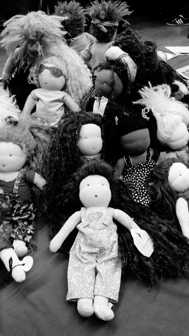 High Angle View Of Heap Of Dolls