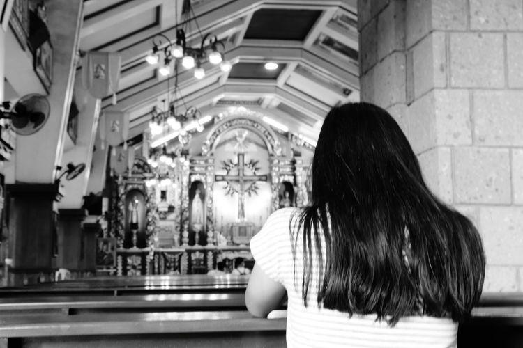 Rear view of teenage girl in church