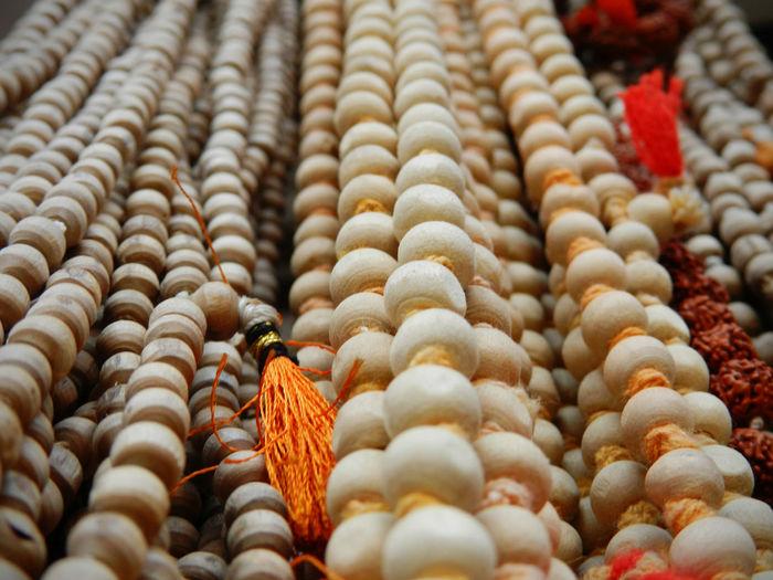 Full frame shot of prayer beads at market stall
