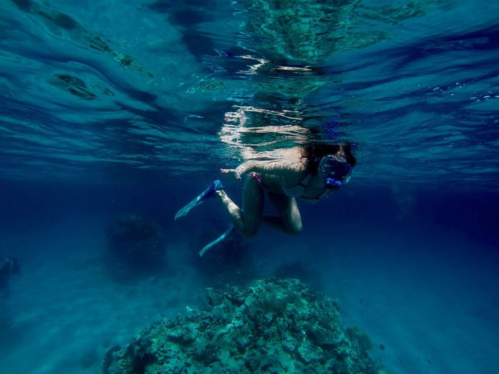 Young Woman Snorkeling Undersea