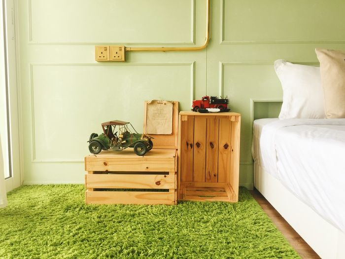Wooden Crates On Rug In Bedroom