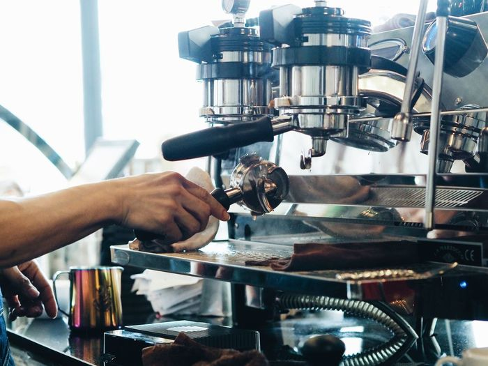 Barista making a coffee cup with coffee machine. Close-up Coffee - Drink Coffee Cup Day Espresso Maker Human Body Part Human Hand Indoors  Industry Machinery Making Manufacturing Equipment Occupation One Person Preparation  Real People Skill  Women Working Workshop