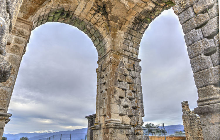 Three pillars of Roman Arch of Caparra. Ancient city ruins at Silver Route, Via de la Plata, Caceres, Spain Ancient Civilization Architecture Day History Low Angle View No People Outdoors Sky