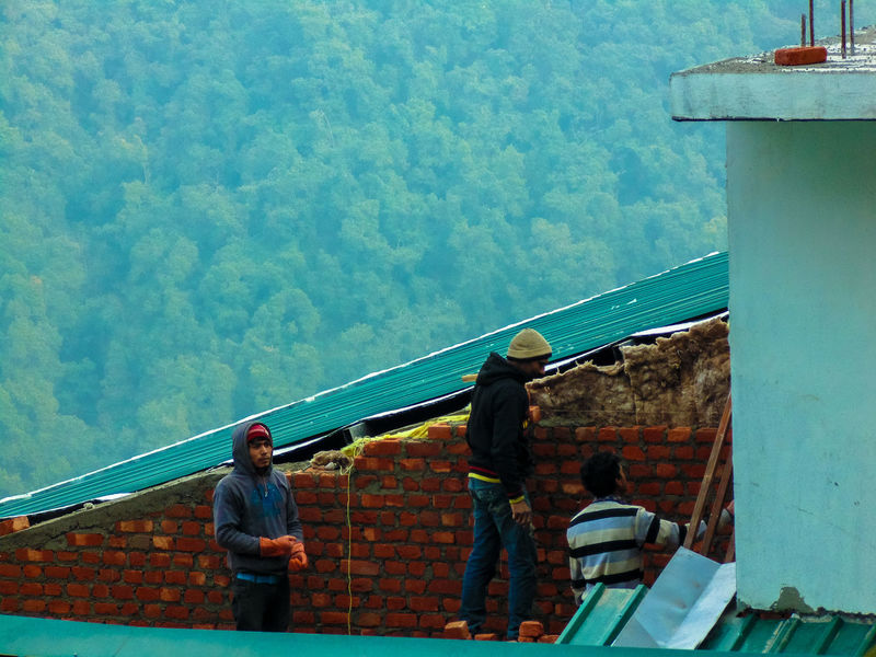 building a brick wall ... Architecture Brick Wall Building Built Structure Cement Daily Everyday Joy Exploring How Do We Build The World? Leisure Activity Lifestyles Men Mountains Mussoorie Real People Rear View Roof Staircase Standing Steps Tadaa Community Tourism Trees Uttarakhand Wall