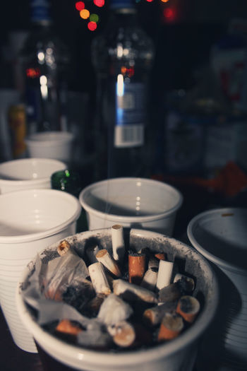 Cigarettes Memories Party Time Wasted Abstract Addiction Ash Ashtray  Bad Habit Burning Candle Canon Canonphotography Cigarette Butt Close-up Day Flame Illuminated Indoors  Large Group Of Objects No People Party Plate Table Vodka