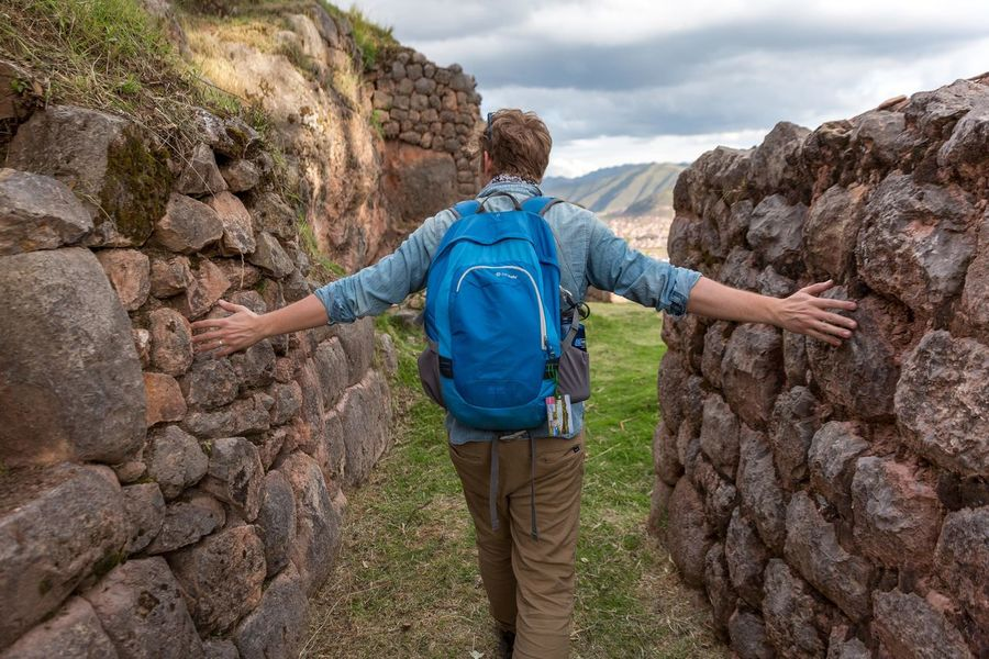 Exploring inca ruins near Cusco Peru. Hiking Adventure Backpack Exploration Adult One Person Only Men People Travel Mountain Vacations Healthy Lifestyle Exploring No Face Feeling Experience