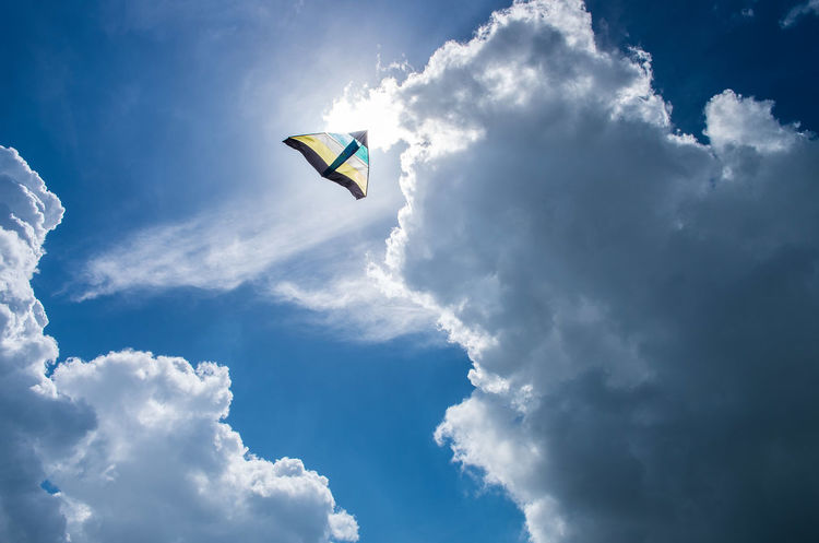 Blue Blue Sky Chilling Cloud Cloud - Sky Cloudy Coast Coastline Day Flying Kite Kites Low Angle View Outdoors Red Kite In Flight Sky