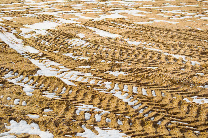 Abundance Backgrounds Beauty In Nature Close-up Day Full Frame Heap Landscape Natural Pattern Nature No People Non-urban Scene Outdoor Photography Outdoors Pattern Pieces Pattern, Texture, Shape And Form Repetition Sand Scenics Snow Tire Tracks Tranquil Scene Tranquility Weather