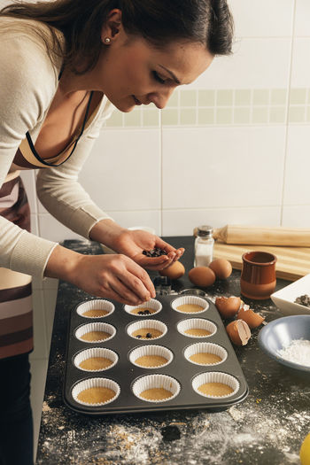 Woman making muffin at home