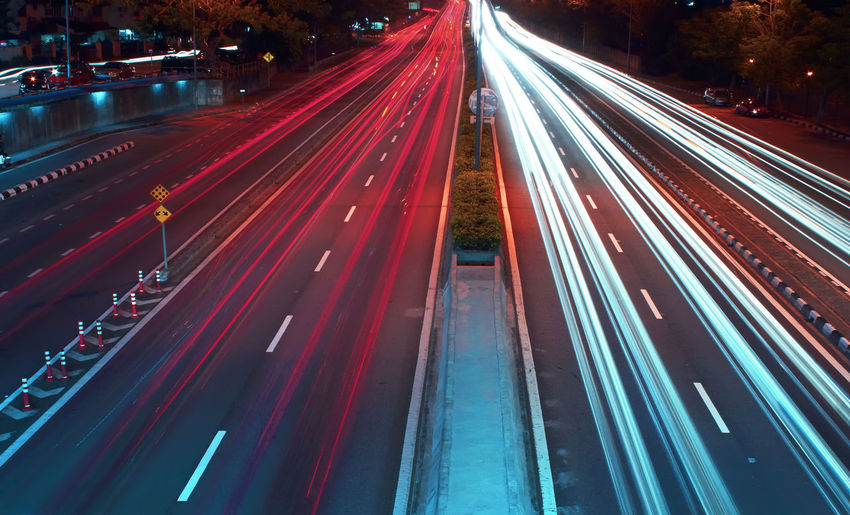 Long exposure photo of traffic with blurred traces from cars, top view. City City Life City Street High Angle View Illuminated Light Trail Long Exposure Motion Night No People Outdoors Red Road Speed Street Street Light Traffic Transportation