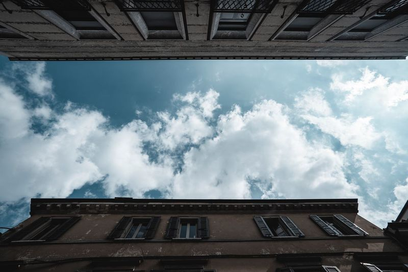 Building Exterior Cloud - Sky Built Structure Architecture Sky Low Angle View Building City High Section House Blue Wall - Building Feature Residential District Outdoors Window Day Nature No People Roof Sunlight
