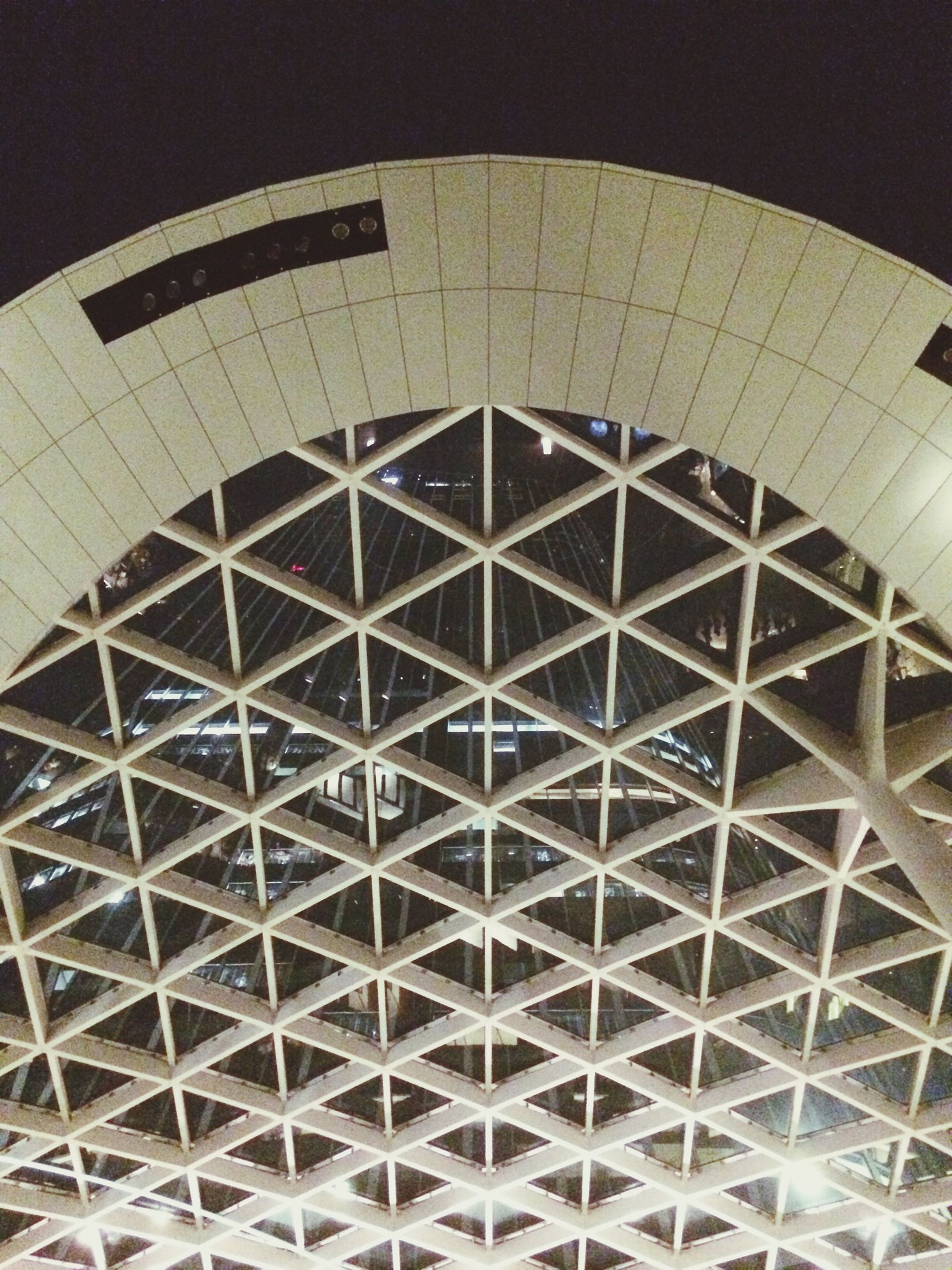 architecture, built structure, low angle view, pattern, indoors, illuminated, ceiling, full frame, backgrounds, geometric shape, modern, building exterior, architectural feature, design, repetition, night, no people, building, shape, circle