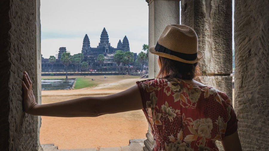 Woman in front of Angkor Wat, Cambodia Rear View Hat One Person Nature Leisure Activity Women Standing Looking At View Cambodia Angkor Angkor Wat Angkor Wat, Cambodia UNESCO World Heritage Site Travel Destinations Traveling Tourism Famous Place Ancient Ancient Civilization Architecture Built Structure Real People Building Exterior