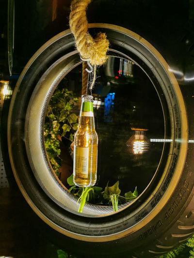 Close-up of illuminated glass bottle