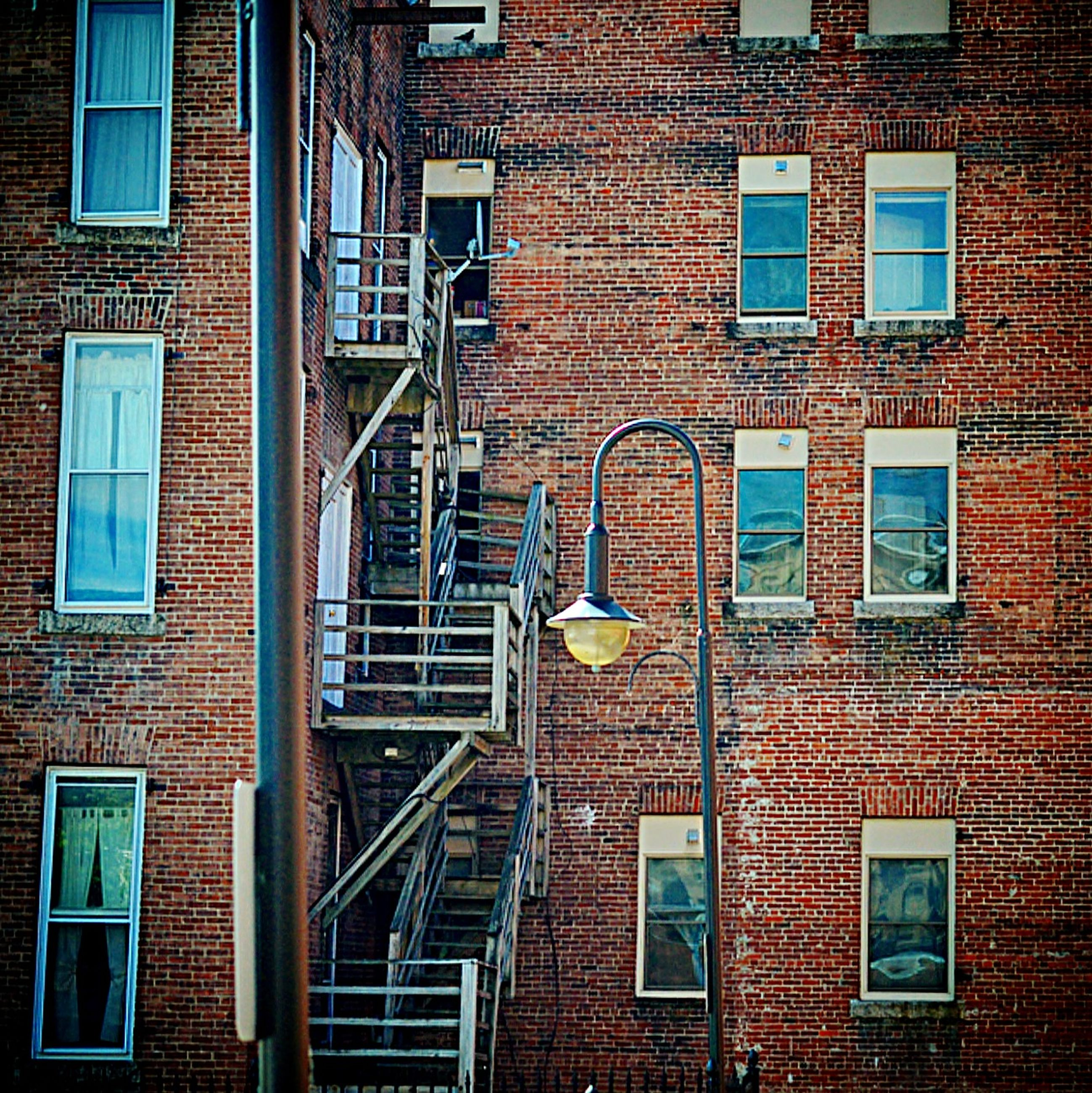 architecture, building exterior, built structure, window, brick wall, residential building, low angle view, building, residential structure, house, brick, full frame, day, wall - building feature, wall, outdoors, old, exterior, no people, city