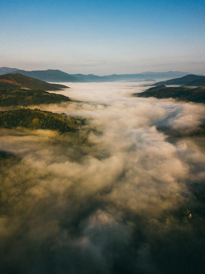 Fog in the mountains of the carpathians, view from the drone