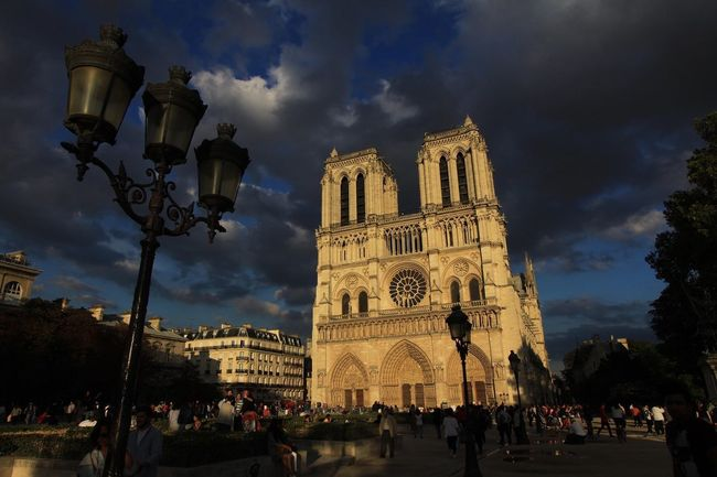 Church Notre Dame De Paris Paris Architecture Building Exterior Built Structure Cloud - Sky Day Large Group Of People Low Angle View Outdoors People Place Of Worship Real People Religion Sky Spirituality Travel Destinations Tree Women