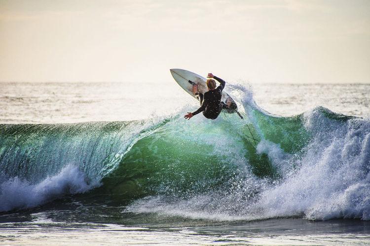 Man surfing in sea waves