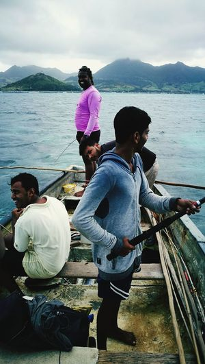 Water Nautical Vessel Sitting Togetherness Men Sea Casual Clothing Adult Fishing People Only Men Fisherman Adults Only Outdoors Young Adult Day Young Men Real People Full Length Mature Adult Mauritius Mauritius Island  Mauritiusexplored
