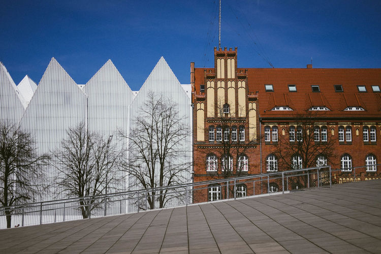 New and old juxtapozed in Szczecin, Poland Poland Szczecin Architecture Bare Tree Blue Building Building Exterior Built Structure City Day Nature No People Outdoors Sky Travel Destinations