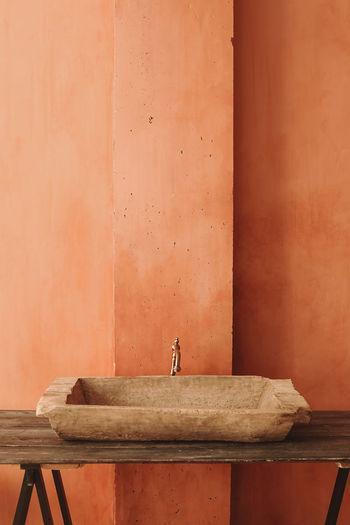 Minimalistic interior style. vintage sink on a wooden shelf. home design