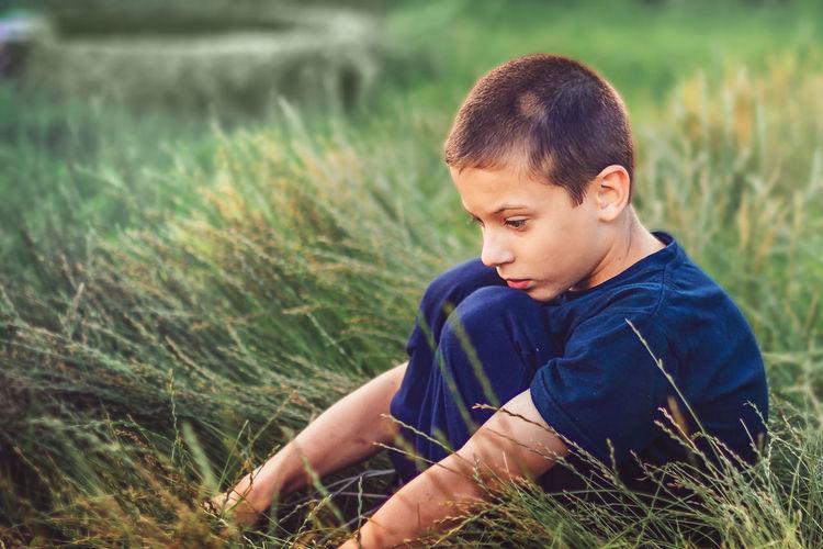 Boy looking away on land