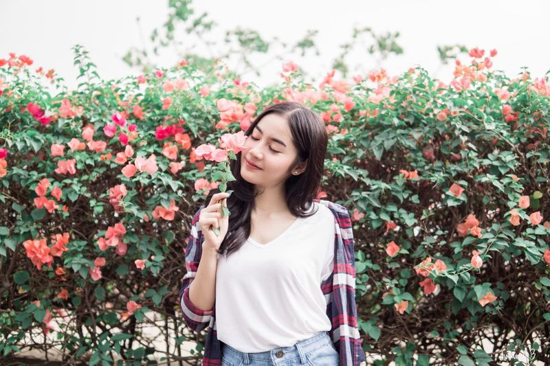 A beautiful girl in the flower garden Park Peace Green Pink Leaf Delight  Bright Girl Fashion Model Odour Garden Cute Beautiful Lady Young Adult Plant Flower One Person Standing Casual Clothing Happiness Nature Freshness Emotion Smiling Day Eyes Closed  Waist Up