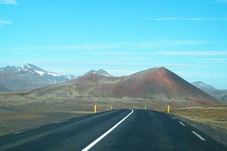 Asphalt Beauty In Nature Day Dividing Line Landscape Mountain Mountain Range Nature No People Non-urban Scene Outdoors Remote Road Road Marking Roadtrip Scenics Sky The Way Forward Tranquil Scene Tranquility Transportation Travel Travel Destinations White Line Winding Road