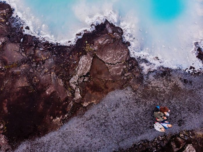 Aerial View Of Friends Standing At Blue Lagoon