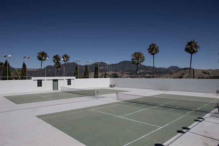 Tennis courts against clear sky