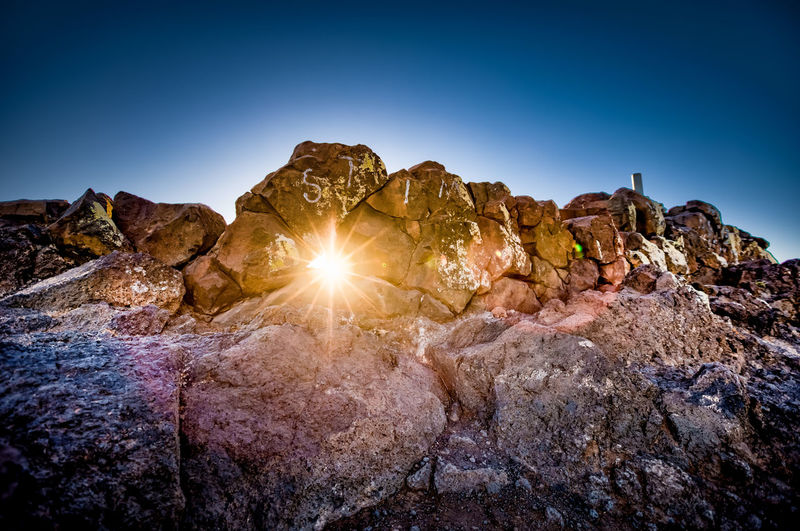 Sunlight Beauty In Nature Blue Clear Sky Day Geology Hole Landscape Mountain Nature No People Outdoors Refelections Rock - Object Rock Formation Rocks Scenics Sky Sun Sunset Tranquil Scene Tranquility Travel Destinations