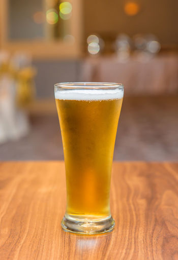 Refreshment Drink Food And Drink Alcohol Glass Drinking Glass Table Beer - Alcohol Beer Beer Glass Focus On Foreground Household Equipment Wood - Material Indoors  Bar - Drink Establishment Still Life Frothy Drink Freshness No People Close-up Bar Counter Pint Glass Lager Wood Grain
