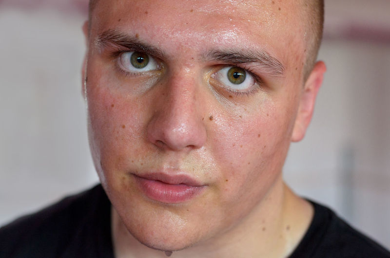 Close-Up Portrait Of Young Man Sweating