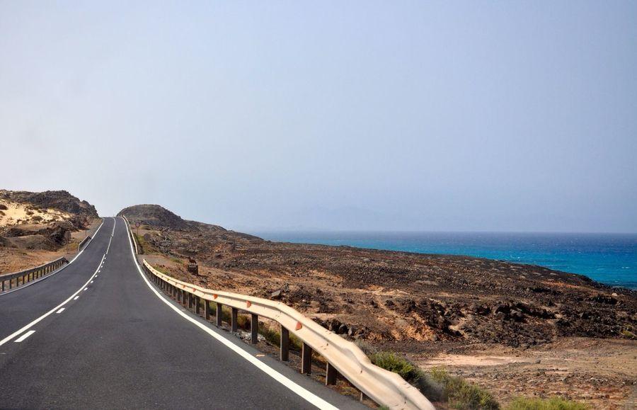 The Journey Is The Destination road trip in sand dunes of corralejo Road Road Trip Trip Traveling Vacation Fuerteventura SPAIN Sand Dune Way Asphalt Ocean Corralejo
