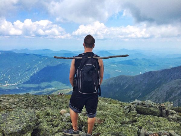 It was a 5 hour climb to the top of Mount Washington  New Hampshire The view was the reward and we spent a while enjoying it. this picture shows my friend just taking it all in. Miles Away