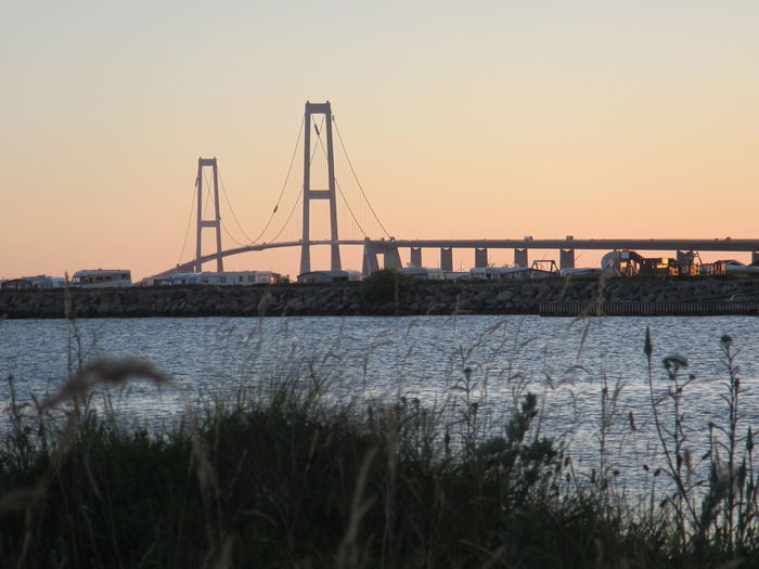 Bridge over water against clear sky