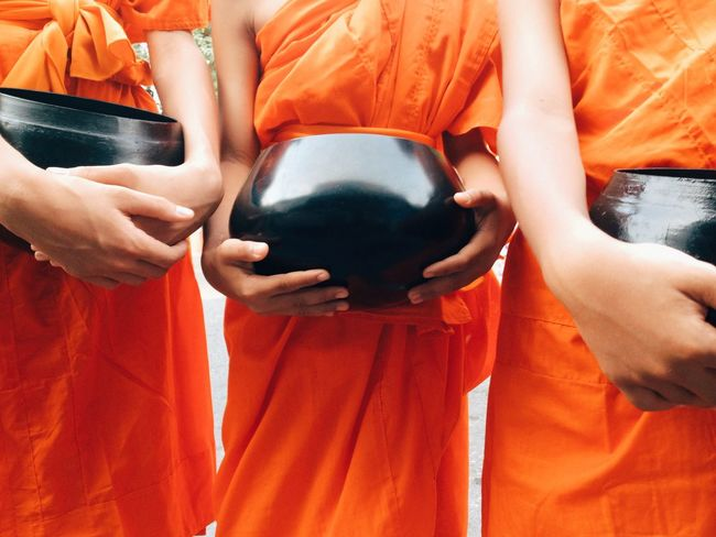 Food offering to a monk background Buddha Monk Walk Thai Thailand Tradition Traditional Culture Buddhism Culture And Tradition Cultures Holding Lifestyles Monk  Monk Budhist Prayer Orange Color Religion Standing Thai Culture Traditional