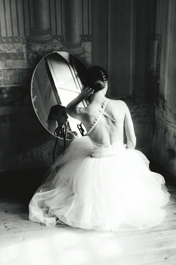 Rear view of young woman in wedding dress