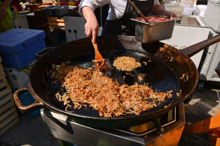 Close-up of fried onions on cooking pan