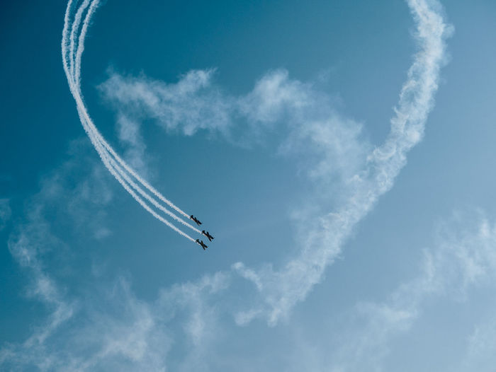 Low Angle View Of Airshow Flying Against Blue Sky