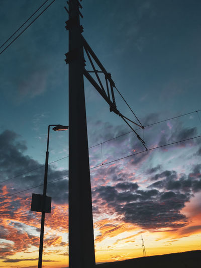 Low angle view of silhouette pole against sky during sunset