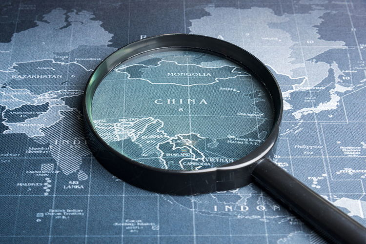 Close-up of magnifying glass on map