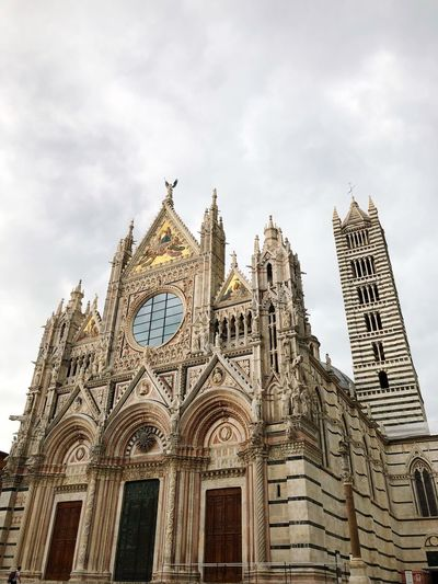 Sienacathedral Italy Siena Cathedral Architecture Built Structure Low Angle View Building Exterior Sky Religion Spirituality Belief Tourism Travel History Building Travel Destinations The Past Spire  Cloud - Sky
