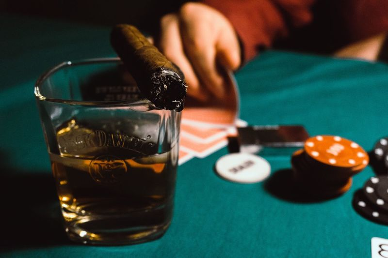 Close-up of alcohol with cigar on table