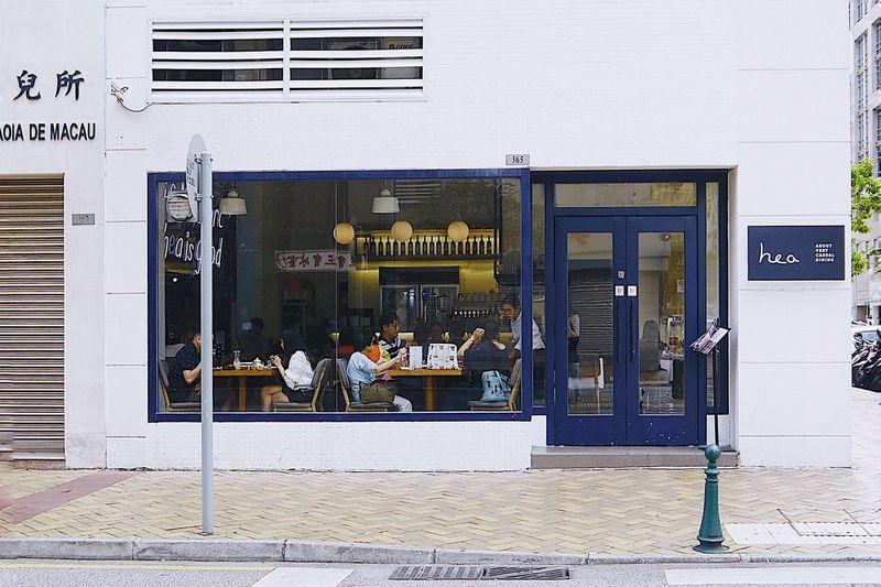 Exploremacau Ihaveathingforwalls Hea Blue Building Exterior Architecture Built Structure Communication Text Western Script Sign City Street Sidewalk Window Building
