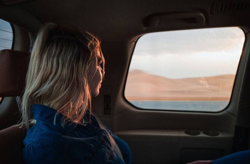 Rear view of woman in car