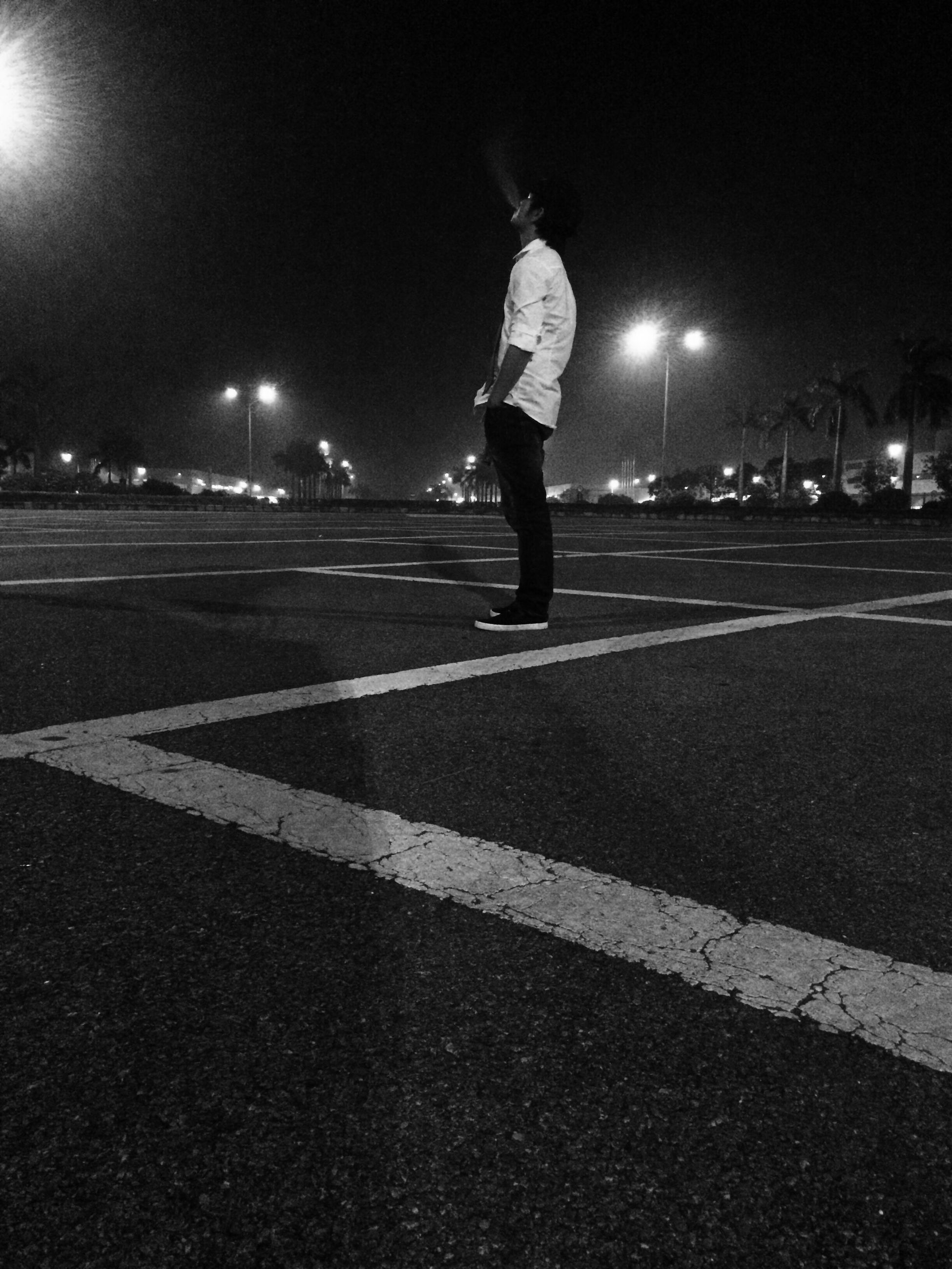 full length, road marking, lifestyles, road, night, street, transportation, leisure activity, skateboarding, motion, on the move, zebra crossing, illuminated, casual clothing, skateboard, outdoors, city, city life, park - man made space, footpath