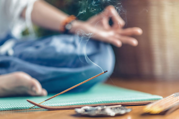 Meditation. Woman Enjoying Incense Stick Meditate Yoga Woman Mudra Hands Lotus Position Incense Sticks Incense Smoke Stick Meditating Relaxation Feet Fragrance Therapy Tradition Aromatic Relax Scent Calm Mindfulness Culture Spirituality Spirit